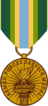 Bronze coin-shaped medal suspended on a multicolored ribbon.