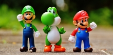 the characters Luigi, Yoshi, and Mario (left to right) from Nintendo games