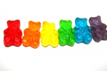 A picture of rainbow colored gummy bears