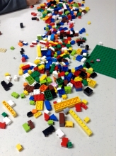 LEGO pieces scattered all over our program table