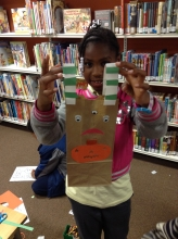 Jonali G. shows off her Monster Treat Bag, complete with handles she made with construction paper