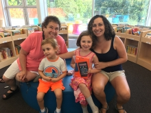 Kindle Fire Raffle winner Eloise with her brother Wesley, mother Rebecca, and Grandma Susan
