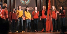 Image of a cappella group Harmony performing