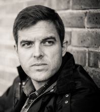 """Head shot of """"Yellow Birds"""" author Kevin Powers"""