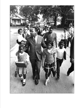 Dr. Martin Luther King, Jr. marching with children