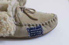 Slippers with a contrasting patch