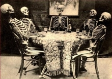 Skeletons around a table