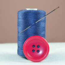 Spool of thread, needle, button