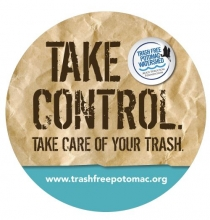 circle sticker that says take control of your trash