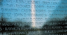 Image of Vietnam Veterans Memorial with reflection of Washington Monument