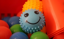 Ball pit with smiley face ball