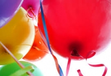 Colorful party balloons with strings.