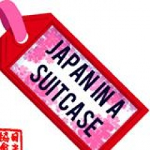 luggage tag with Japan In A Suitcase written on it
