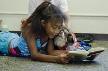 kid and dog reading