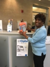 Photo of Mrs. E Butler Holland and her new tablet prize