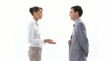 A photo of a woman and man talking