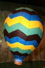 Image of piñata in shape of hot air balloon.