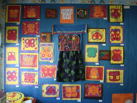 Two real molas surrounded by paper molas
