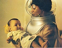 woman in biohazard suit holding baby