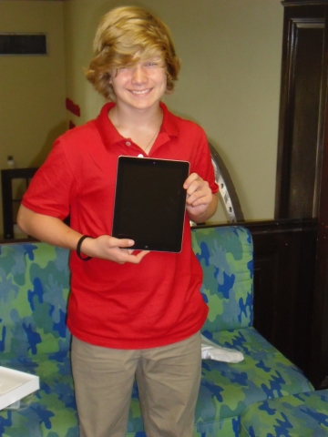 Edward Maloney holding IPad prize