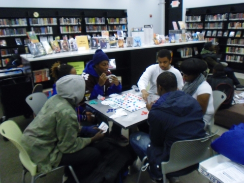 Teens Playing Sequence Board Game