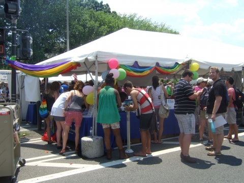 The DCPL booth at the 2012 DC Pride Festival, full of patrons and interested people!
