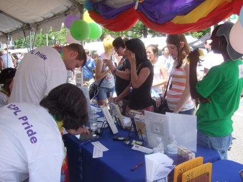 Staff assist patrons crowding around our booth at the 2012 DC Pride Festival