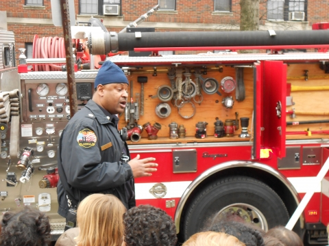 Photo:  Lt. Adams Explains Tools on the Fire Truck