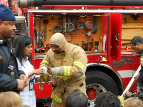 Photo: Putting on Protective Clothing