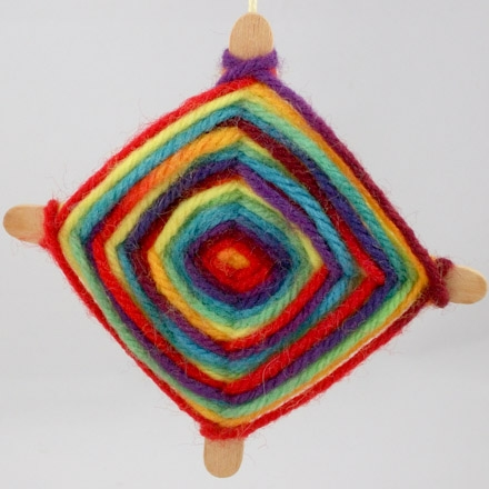 Image of God's eye craft; colorful yarn wrapped around cross-shaped sticks