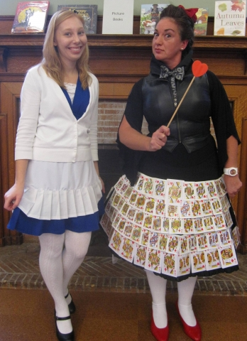 Miss Heather and Miss Julie dressed like Alice in Wonderland and The Queen of Hearts