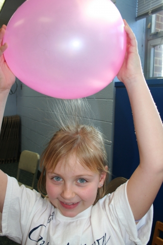Girl Holding up ballon