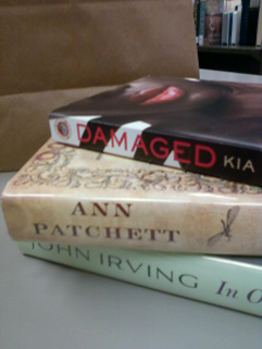 Brown bag with book stack