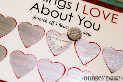 Valentine with silver hearts, one half-scratched off to reveal a hidden message