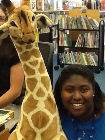 Whitney and a giraffe in Children's
