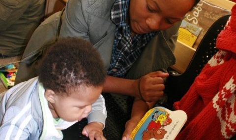Image of baby captivated by a book