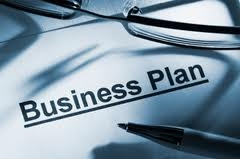 Picture of business plan with pen and eyeglasses