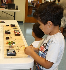 children doing electricity experiment