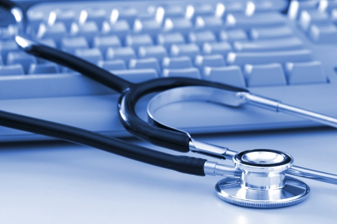 Photo of keyboard and stethoscope