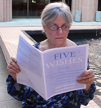 Older woman reading Five Wishes document