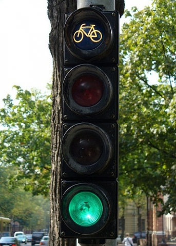 """Stoplight on green with a signal for bicyclists to """"go."""""""