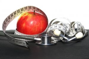 Picture of apple, stethoscope, and tape measure