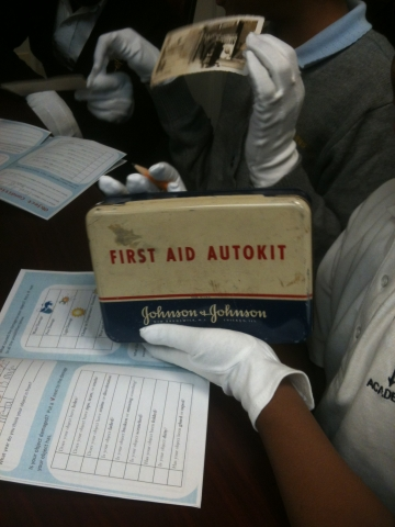 Student handles a First Aid Autokit