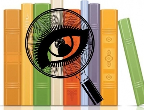 Clip art of a magnifying glass over a stack of books