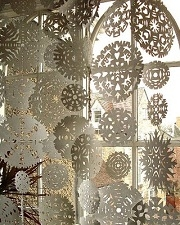 Photo of paper snowflakes in a window