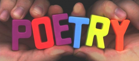 """Hands holding colorful letter blocks that spell the word """"poetry"""""""