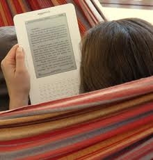 Person Reading on a Kindle eReader