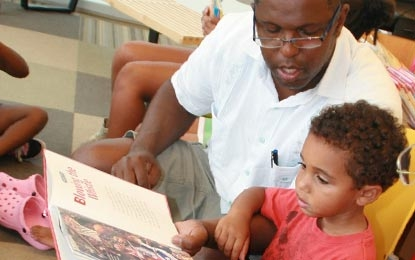 Picture of a man reading to a child
