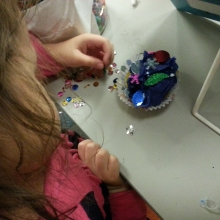 Picture of a girl making a tissue paper cupcake