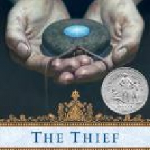 Thief cover - two pale hands hold a piece of jewelry that is a gray stone with a brighter blue stone